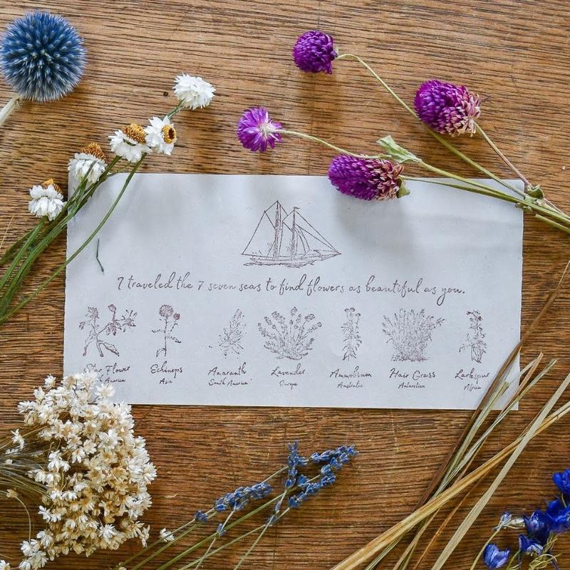 Roth Tevet message in a bottle dried flowers with note about sailing the 7 seas to find them