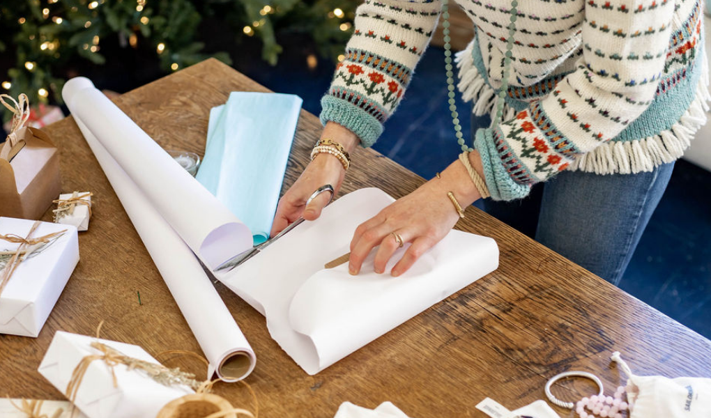 wrapping presents with beachy gift wrap for a coastal christmas
