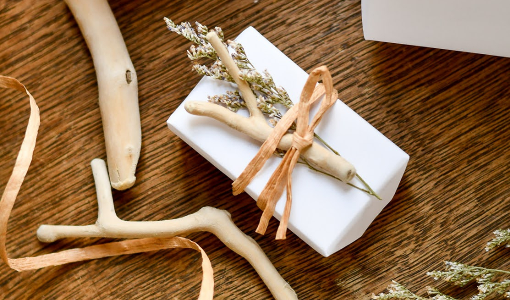 beachy gift wrap with drift wood, dried flowers, and twine for a coastal christmas