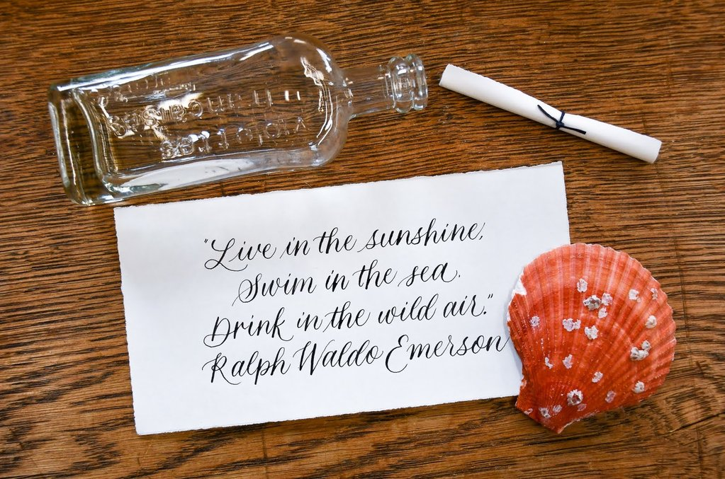 handwritten calligraphy message in a bottle