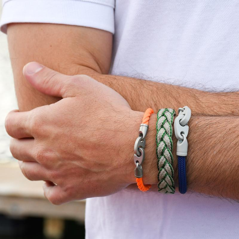 men's nautical bracelet stack with catch single rope bracelet in orange, league magnetic braided bracelet in green, and big brummel bracelet with italian braided cord in blue