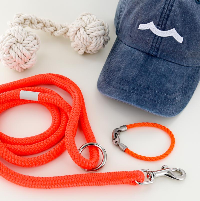 mens nautical rope bracelet, rope dog leash, rope dog toy, and hat in buoy orange