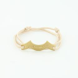 Wave Chaser Rope Bracelet in Brass in beige with slip knots